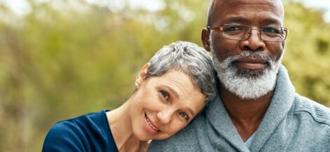 Man and woman smiling in the midst of a medical journey
