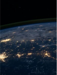 Satellite image of Earth across a broad landscape at night