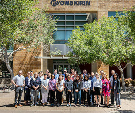 Group portrait of Kyowa Kirin North America employees in front of an office building