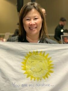 A white flag with a smiling sun drawing
