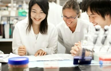 Three scientists working at a laboratory bench at Kyowa Kirin North America