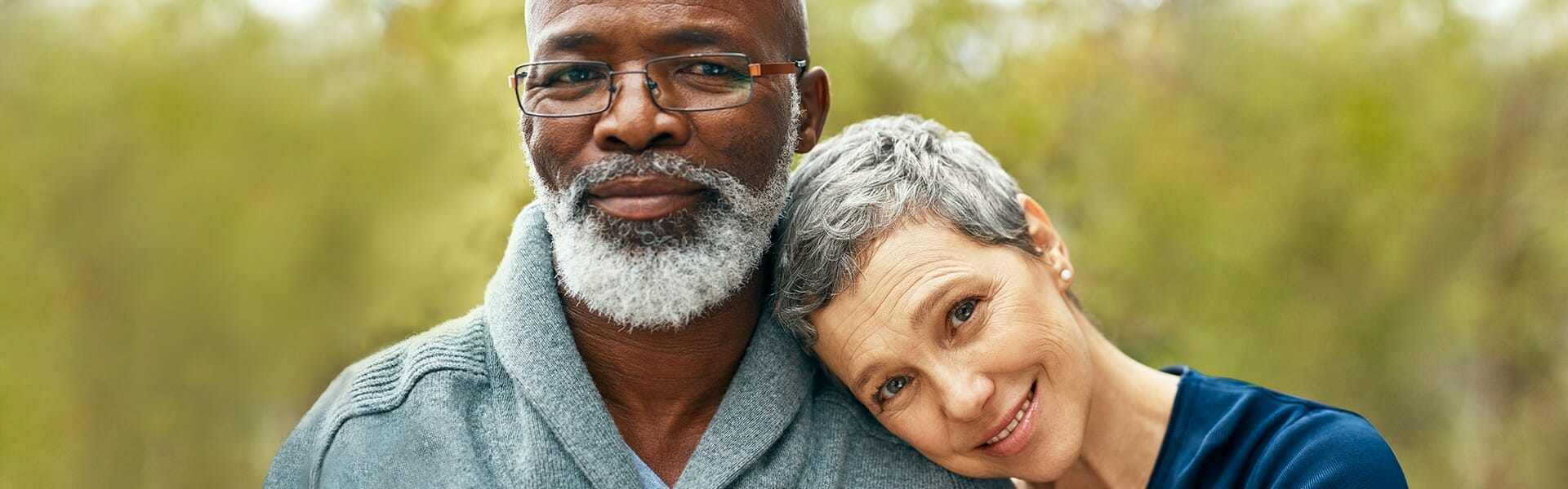 Man and woman smiling and leaning into each other