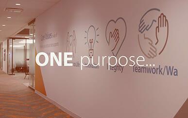 Opening screen of the video titled 'One Kyowa Kirin,' featuring a hallway at Kyowa Kirin North America